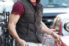 With marsala t-shirt, puffer vest, white pants and big bag