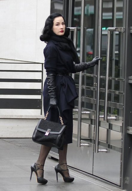 With midi dress, navy blue coat, black pumps and black bag