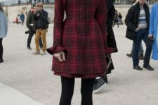 With mini dress, black tights and marsala heels