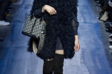 With mini dress, fur mini coat, high boots and small bag