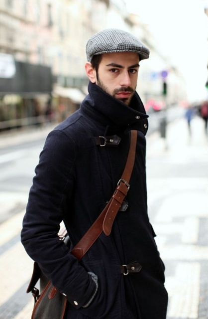 With navy blue coat and leather crossbody bag