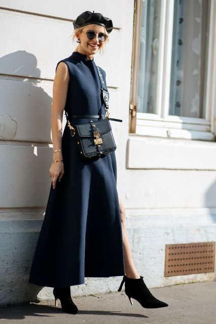 With navy blue dress, black ankle boots and crossbody bag