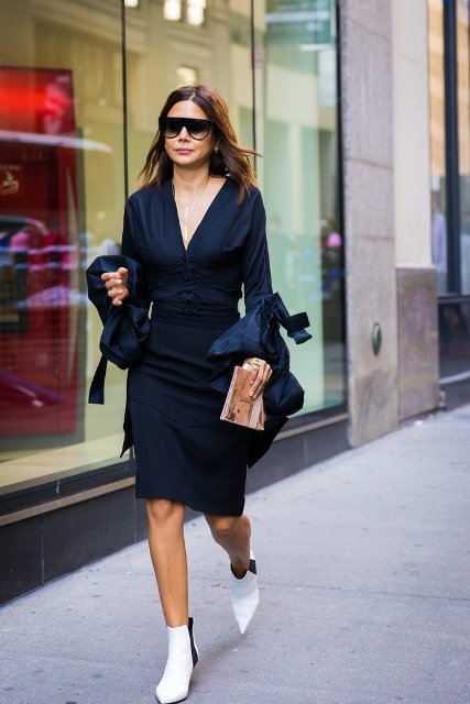 With navy blue knee-length dress