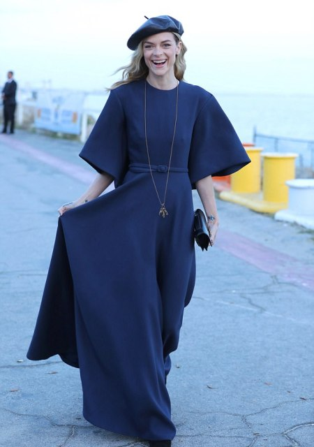 With navy blue maxi dress and black mini clutch