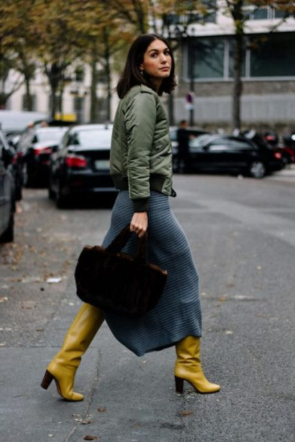 With olive green jacket, midi skirt and black bag