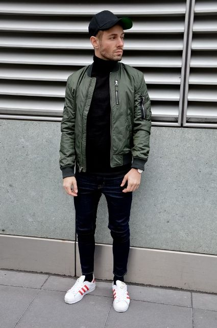 With olive green puffer jacket, black pants, white and red sneakers and cap