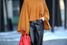 With orange oversized sweater, red pumps and red bag