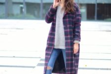 With oversized sweater, skinny jeans and cutout boots