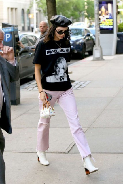 With pale pink pants, white boots, mini bag and t-shirt