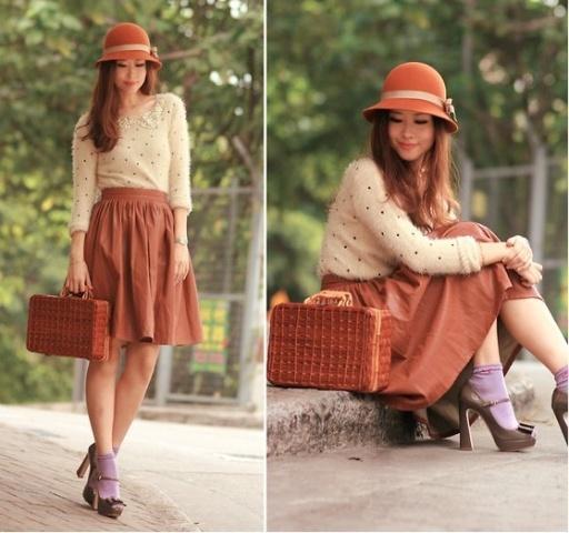 With polka dot blouse, A-line skirt, lilac socks, high heels and bag