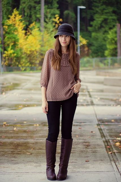 With polka dot blouse, skinny pants and purple boots