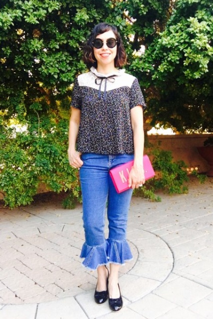 With printed blouse, black flats and pink clutch