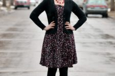 With printed dress, black jacket and black tights