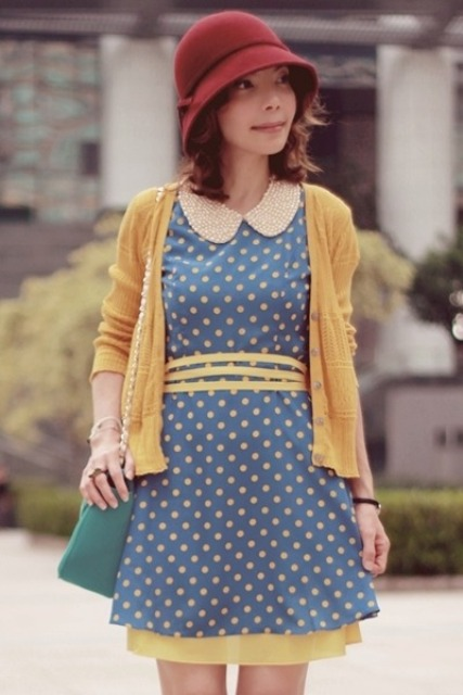 With printed dress, yellow jacket and mini bag