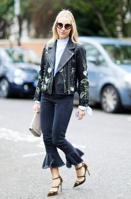 With printed leather jacket, high heels and clutch
