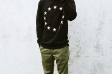 With printed swearshirt, olive green pants and sneakers
