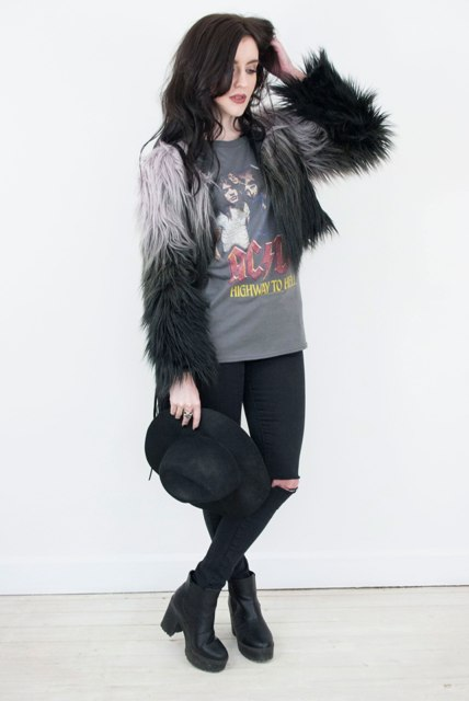 With printed t shirt, jeans, platform boots and hat