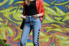With red leather jacket, black top and red pumps
