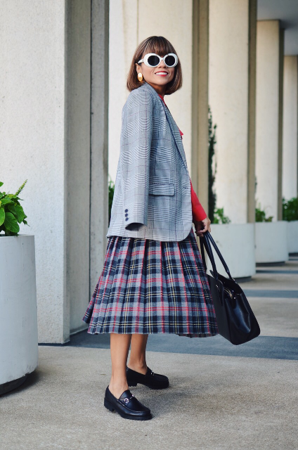 With red shirt, plaid midi skirt, flat shoes and bag