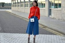 With red sweater, printed ankle boots and mini bag