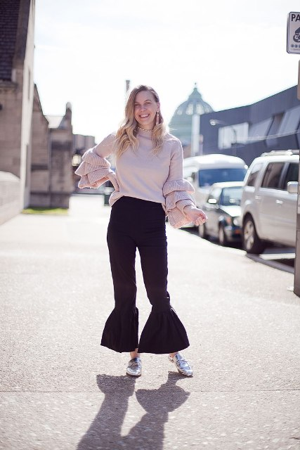 With ruffle sweater and metallic loafers