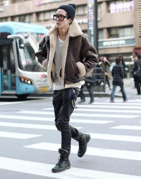 With shearling jacket, white shirt, dark gray pants and mid-calf boots