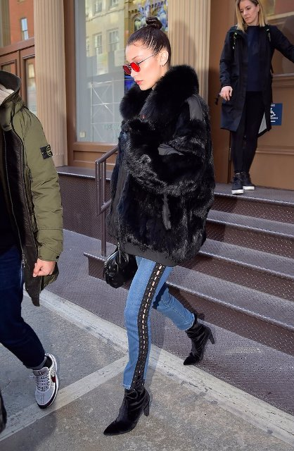 With short fur coat, velvet boots and leather bag