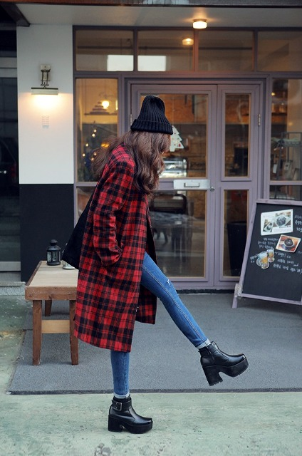 With skinny jeans, black platform boots and black beanie