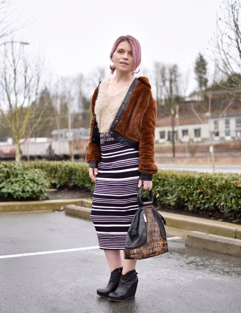 With striped midi skirt, beige shirt, printed bag and black boots