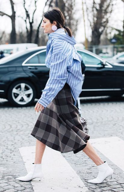 With striped shirt and checked skirt