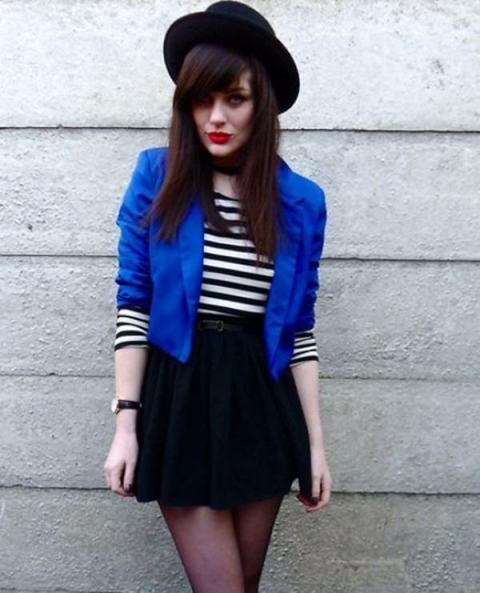 With striped shirt, blue crop blazer and black mini skirt