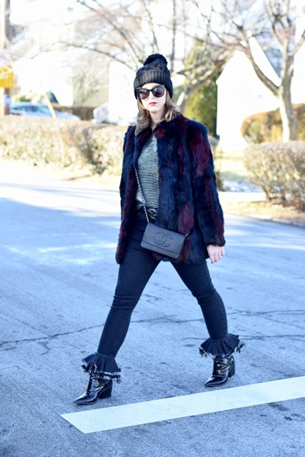 With striped shirt, fur short coat, crossbody bag, black hat and boots