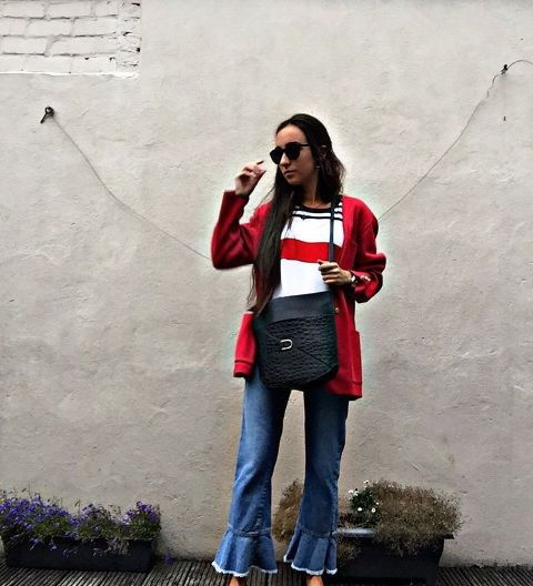 With striped shirt, red cardigan and black bag