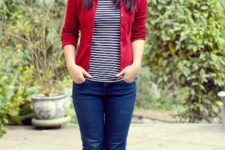 With striped shirt, red jacket, jeans and high boots