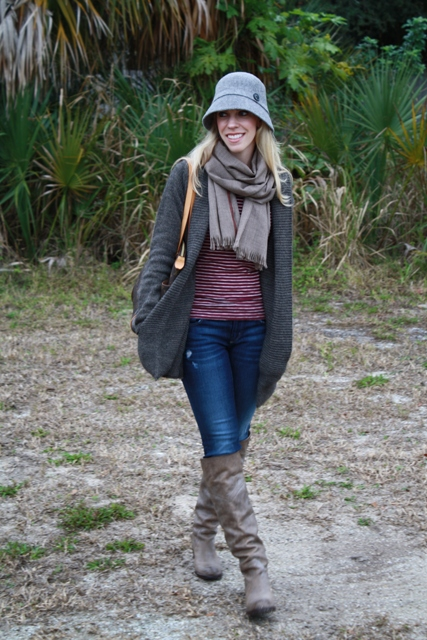 With striped shirt, skinny jeans, gray boots, gray cardigan and scarf