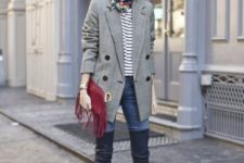 With striped shirt, skinny jeans, over the knee boots and marsala fringe clutch