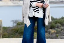 With striped shirt, white cardigan and black cutout boots