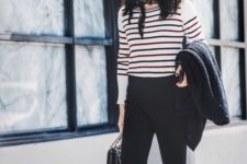 With striped sweater, platform shoes and bag