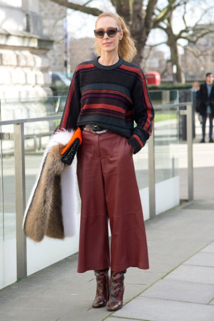 With striped sweater, printed boots and clutch