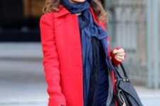 With striped trousers, blue scarf, red coat and black leather bag