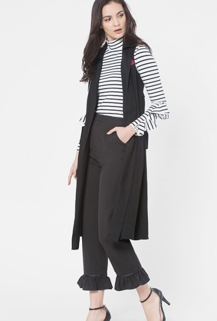 With striped turtleneck, midi vest and black shoes
