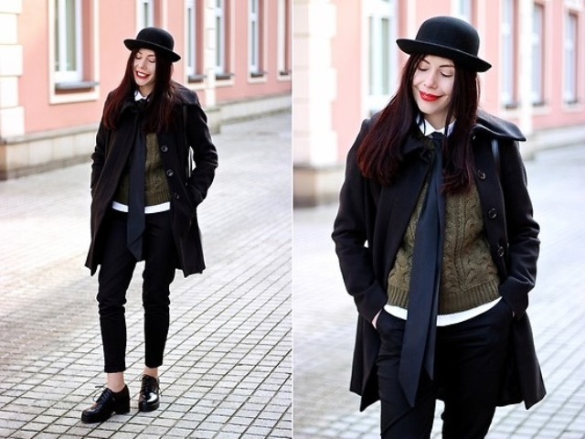 With sweater, black coat, crop pants and boots