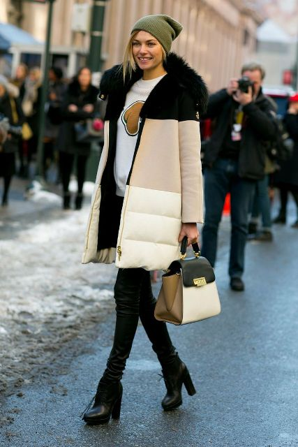 With sweatshirt, skinny pants, heeled boots and three color bag