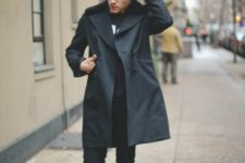 With trench coat, skinny pants, navy blue boots and black shirt