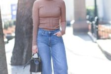 With turtleneck, white sneakers and black mini bag