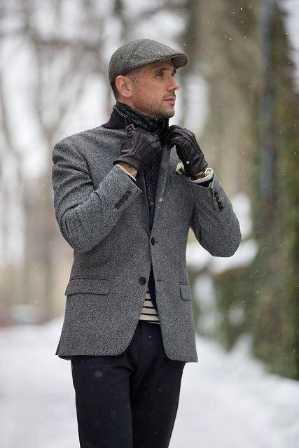 With tweed jacket, striped shirt, black gloves and black pants