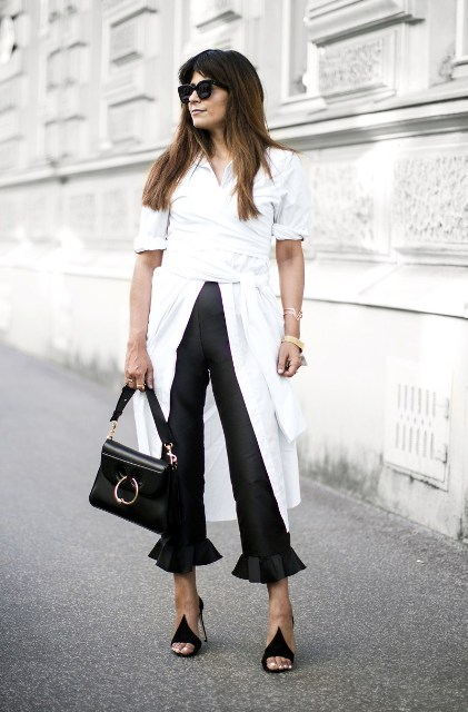 With white blouse, black heels and small bag