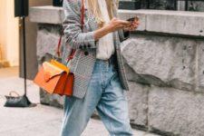 With white button down shirt, boyfriend jeans, heels and orange bag