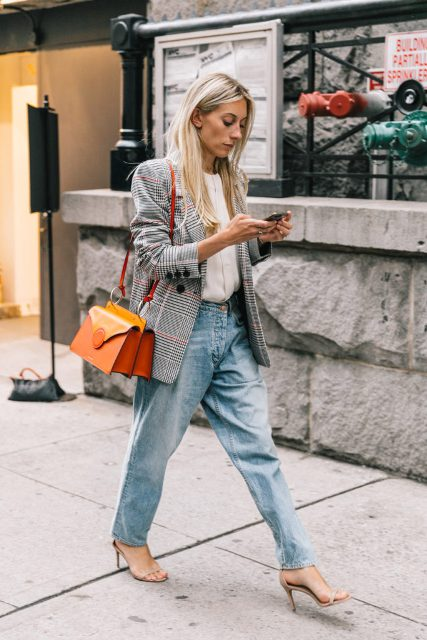 With white button down shirt, boyfriend jeans, heels and orange bag