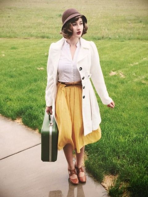 With white button down shirt, yellow skirt, brown shoes and white coat